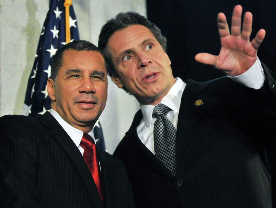 Former NYS Gov. David Paterson, left, and Gov. Andrew Cuomo during the announcement of a Capitol exhibit honoring prominent African-American New Yorkers in recognition of Black History at the Capitol Wednesday Feb. 15, 2012.   (John Carl D'Annibale / Times Union) Photo: John Carl D'Annibale / 00016444A