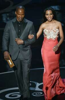 Actor Jamie Foxx and actess Kerry Washington present onstage during the Oscars held at the Dolby Theatre on February 24, 2013 in Hollywood, California. Photo: Kevin Winter, Getty Images / 2013 Getty Images