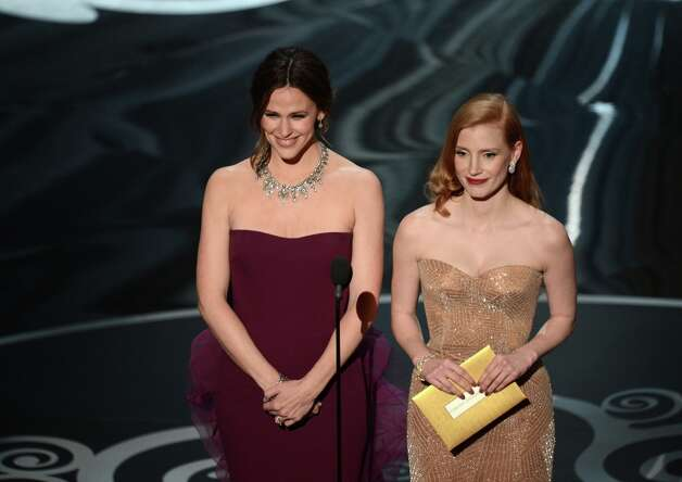 Actresses Jennifer Garner and Jessica Chastain present onstage during the Oscars held at the Dolby Theatre on February 24, 2013 in Hollywood, California. Photo: Kevin Winter, Getty Images / 2013 Getty Images