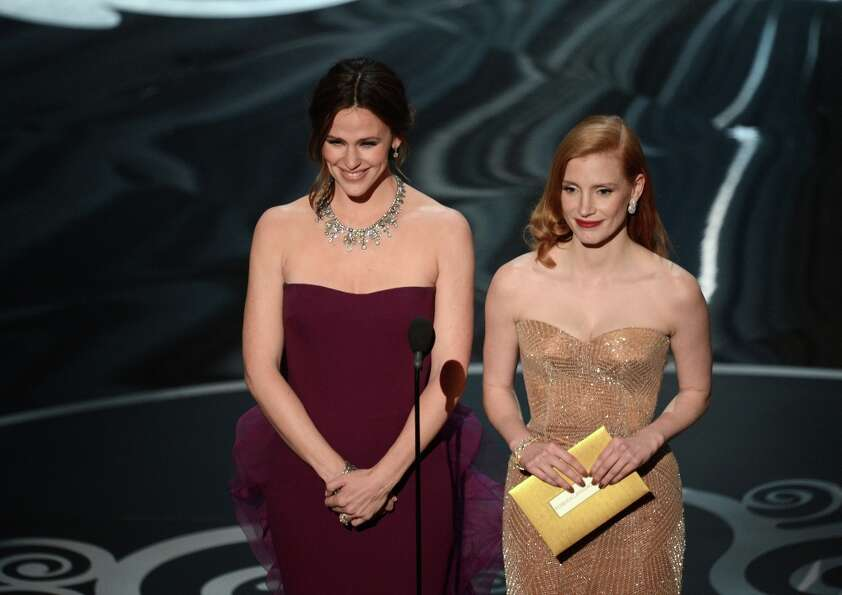 Actresses Jennifer Garner and Jessica Chastain present onstage during the Oscars held at the Dolby T