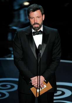Ben Affleck presents an award during the Oscars at the Dolby Theatre on Sunday Feb. 24, 2013, in Los Angeles.  (Photo by Chris Pizzello/Invision/AP) Photo: Chris Pizzello, Associated Press / Invision