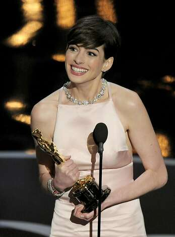 "Anne Hathaway accepts the award for best actress in a supporting role for ""Les Miserables"" during the Oscars at the Dolby Theatre on Sunday Feb. 24, 2013, in Los Angeles.  (Photo by Chris Pizzello/Invision/AP) Photo: Chris Pizzello, Associated Press"