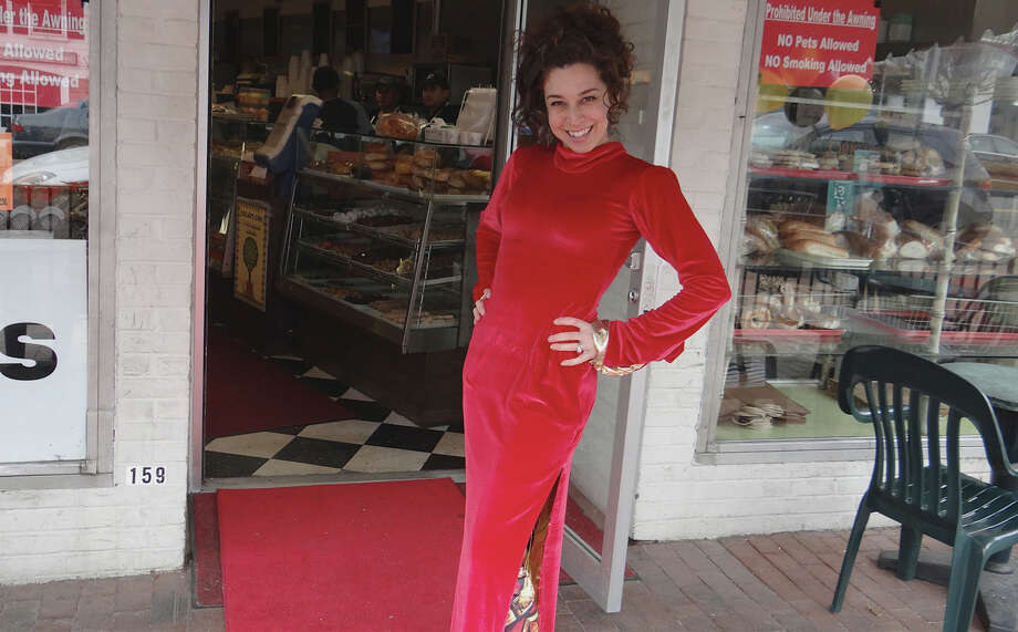 "Susie Mastropietro models her ""red carpet dress"" on a mock red carpet at Oscar's Deli, where the 2nd annual n'Oscars Party was held Sunday.  WESTPORT NEWS, CT 2/24/13 Photo: Mike Lauterborn / Westport News contributed"