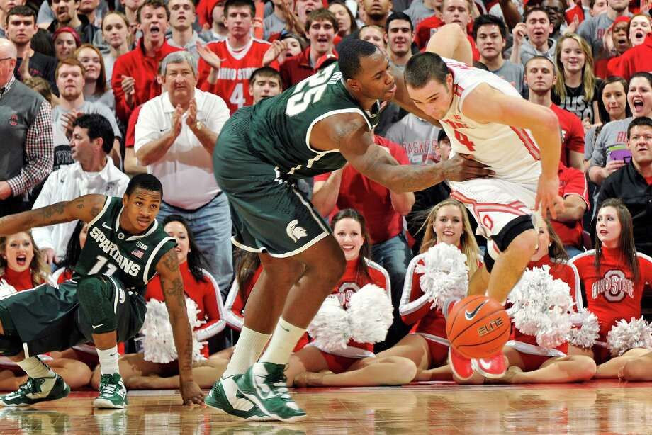 Ohio State defensive demon Aaron Craft, right, showed an offensive side to his game that frustrated Michigan State players like Derrick Nix. Photo: Jamie Sabau, Stringer / 2013 Getty Images