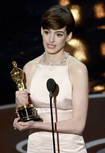 Actress Anne Hathaway accepts the Best Supporting Actress award for Les Miserables onstage during th