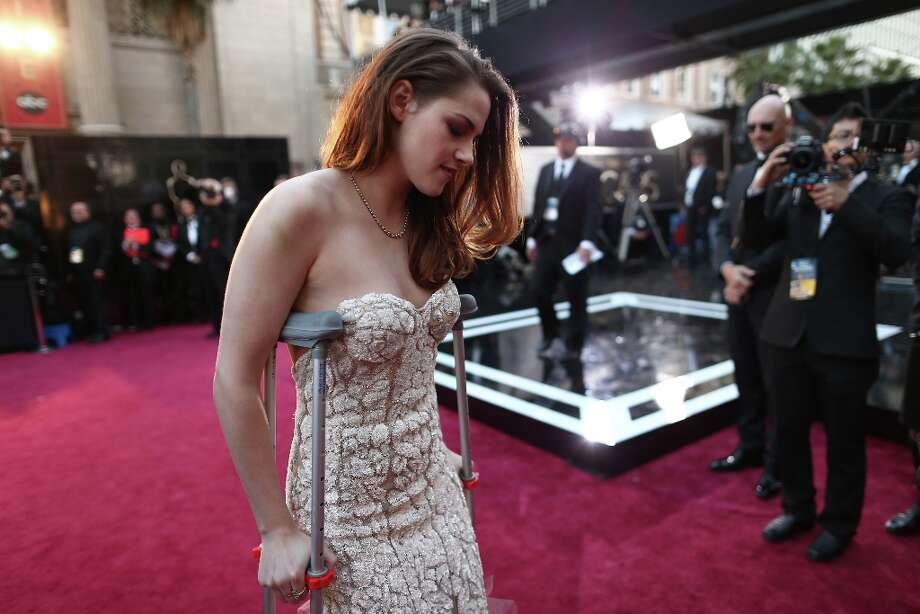 Actress Kristen Stewart arrives on crutches at the Oscars held at Hollywood & Highland Center on February 24, 2013 in Hollywood, California. Photo: Christopher Polk, Getty Images / 2013 Getty Images