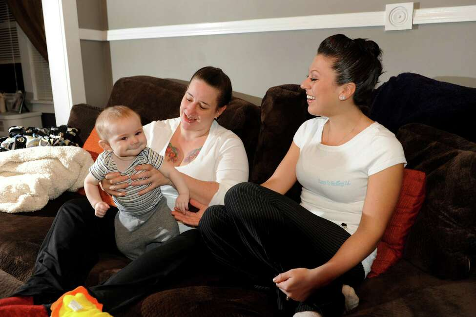 Chelsea Prisco, maternity coach and consultant, right, with client Devon Votto of Albany and her 5-month-old son Caiden on Friday, Feb. 15, 2013, at Prisco's home in Schenectady, N.Y. (Cindy Schultz / Times Union)
