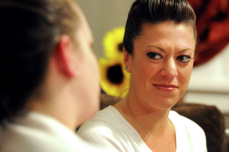 Chelsea Prisco, maternity coach and consultant, right, listens to client Devon Votto of Albany on Friday, Feb. 15, 2013, at Prisco's home in Schenectady, N.Y. (Cindy Schultz / Times Union)