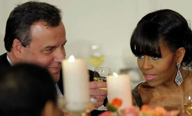 New Jersey Gov. Chris Christie shares a toast with first lady Michelle Obama as President Barack Obama welcomed the governors of the National Governors Association to the 2013 Governors' Dinner at the White House in Washington, Sunday, Feb. 24, 2013. (AP Photo/Susan Walsh) Photo: Susan Walsh