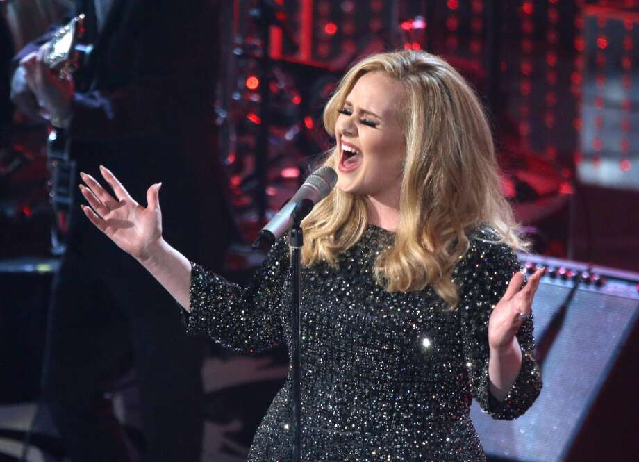 HOLLYWOOD, CA - FEBRUARY 24:  Singer Adele performs onstage during the Oscars held at the Dolby Theatre on February 24, 2013 in Hollywood, California.  (Photo by Mark Davis/WireImage)