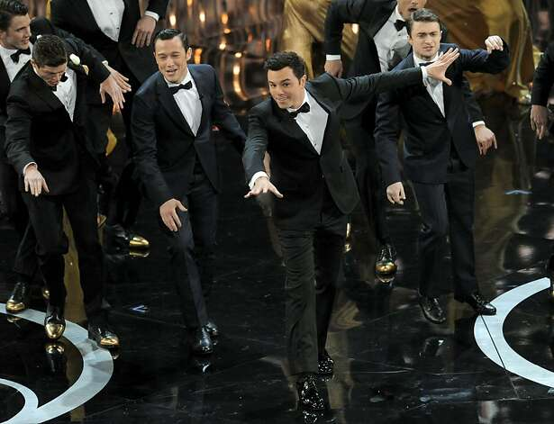 From second left, actors Joseph Gordon-Levitt, Seth MacFarlane and Daniel Radcliffe perform onstage during the Oscars at the Dolby Theatre on Sunday Feb. 24, 2013, in Los Angeles.  (Photo by Chris Pizzello/Invision/AP) Photo: Chris Pizzello, Associated Press