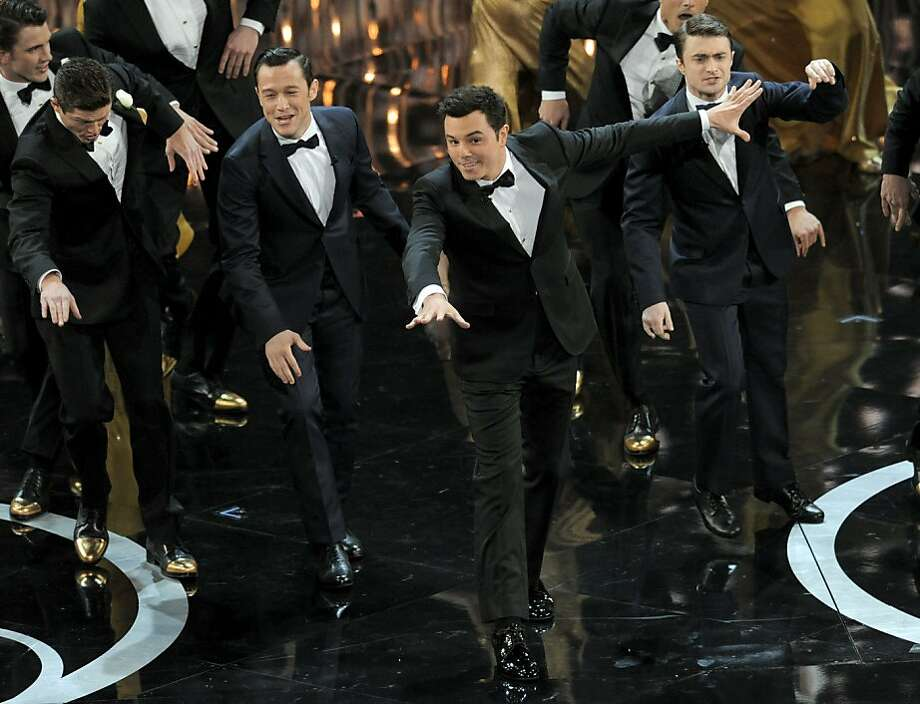 Oscar host Seth MacFarlane (second from right) with actors Joseph Gordon-Levitt (second from left) and Daniel Radcliffe. Photo: Chris Pizzello, Associated Press