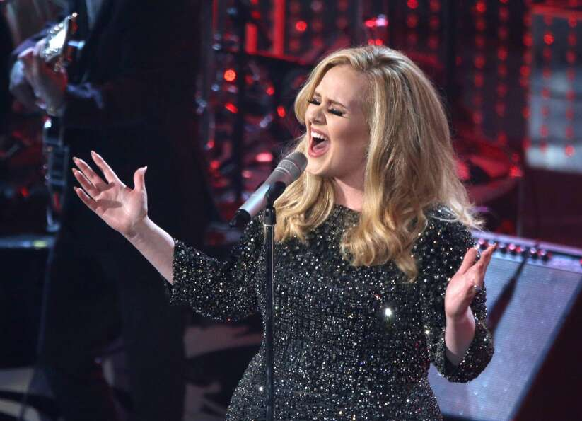 Singer Adele performs onstage during the Oscars.