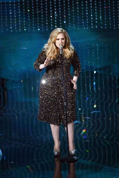 Singer Adele performs onstage during the Oscars held at the Dolby Theatre on February 24, 2013 in Ho