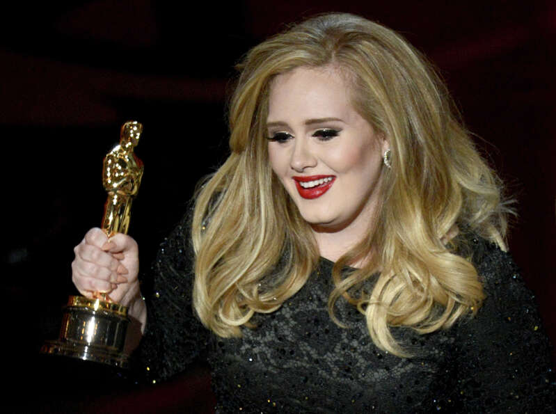 Singer Adele Adkins accepts the Best Original Song award for Skyfall from Skyfall onstage during the