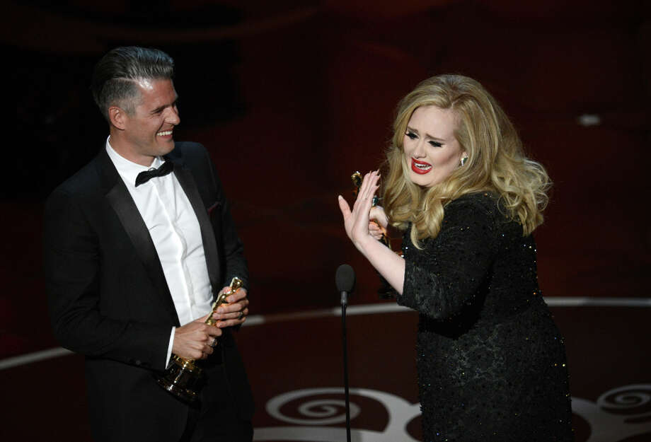 Song writer Paul Epworth and singer Adele Adkins accept the Best Original Song award for Skyfall from Skyfall onstage during the Oscars held at the Dolby Theatre on February 24, 2013 in Hollywood, California. Photo: Kevin Winter, Getty Images / 2013 Getty Images