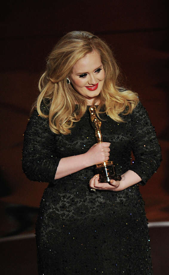 Adele Adkins accepts the Oscar onstage at the 85th Annual Academy Awards on February 24, 2013 in Hollywood, California. Photo: ROBYN BECK, AFP/Getty Images / 2013 AFP