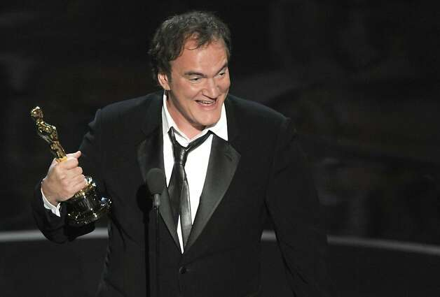 "Quentin Tarantino accepts the award for best original screenplay for ""Django Unchained"" during the Oscars at the Dolby Theatre on Sunday Feb. 24, 2013, in Los Angeles.  (Photo by Chris Pizzello/Invision/AP) Photo: Chris Pizzello, Associated Press"