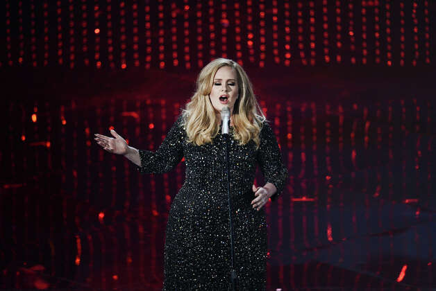 Singer Adele performs onstage during the Oscars held at the Dolby Theatre on February 24, 2013 in Hollywood, California. Photo: Kevin Winter, Getty Images / 2013 Getty Images