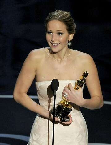 Jennifer Lawrence accepts as best actress. Photo: Chris Pizzello, Associated Press