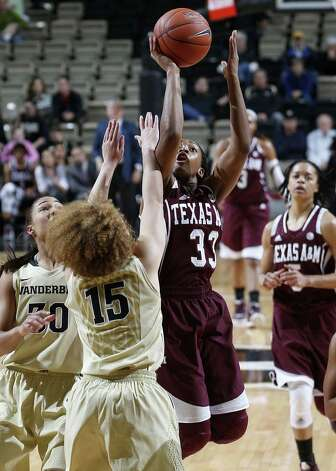 Guard Courtney Walker, putting up a shot in the first half, and the Aggies managed only 30.9 percent shooting Sunday. Photo: Joe Howell / Associated Press