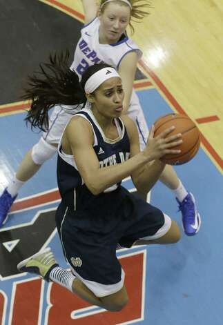 Notre Dame star Skylar Diggins, driving to the basket past DePaul's Megan Rogowski, led the Irish to their 20th consecutive victory. Photo: Nam Y. Huh / Associated Press