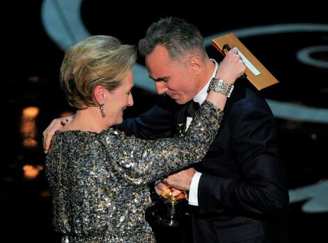 Meryl Streep, left, presents the award for best actor in a leading role to Daniel Day-Lewis for Lincoln during the Oscars at the Dolby Theatre on Sunday Feb. 24, 2013, in Los Angeles.  (Photo by Chris Pizzello/Invision/AP) Photo: Chris Pizzello, Associated Press / Invision