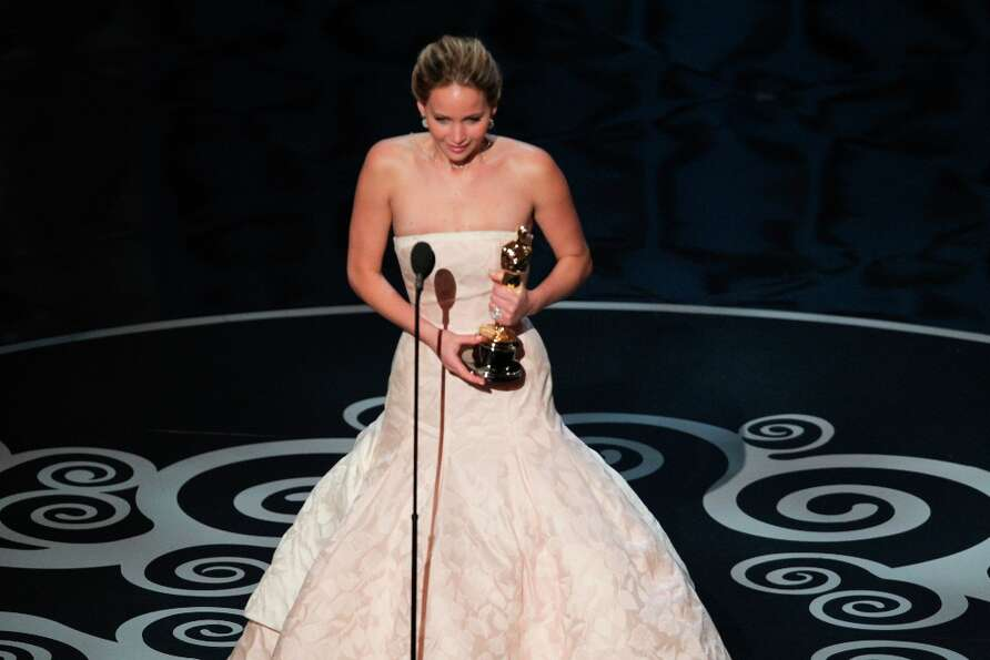 Jennifer Lawrence receives the award for best actress for her role in the film Silver Linings Playbo