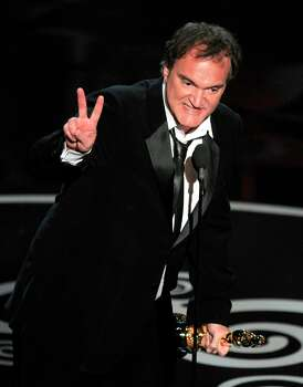 Quentin Tarantino accepts the award for best writing - original screenplay for Django Unchained during the Oscars at the Dolby Theatre on Sunday Feb. 24, 2013, in Los Angeles.  (Photo by Chris Pizzello/Invision/AP) Photo: Chris Pizzello, Associated Press / Invision