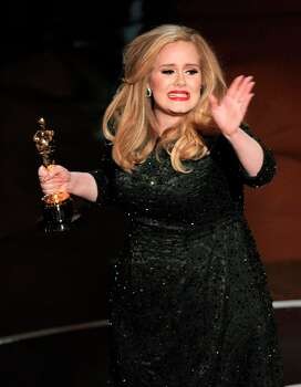 Singer Adele accepts the award for best original song for Skyfall from the film Skyfall during the Oscars at the Dolby Theatre on Sunday Feb. 24, 2013, in Los Angeles.  (Photo by Chris Pizzello/Invision/AP) Photo: Chris Pizzello, Associated Press / Invision
