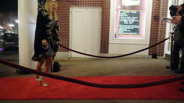 "Elizabeth Galt walks the red carpet as she arrives for the Avon Theatre's annual Oscar party at the theatre on Bedford Street in Stamford, Conn., Feb. 24, 2013. Guests got to walk a red carpet as they arrive to the event which included several James Bond features in celebration of the 50th anniversary of Bond films. A ""Bond Girl"" strolled the party in a bikini modeled after Ursula Andress in the first Bond film, Dr. No. Photo: Keelin Daly / Keelin Daly"
