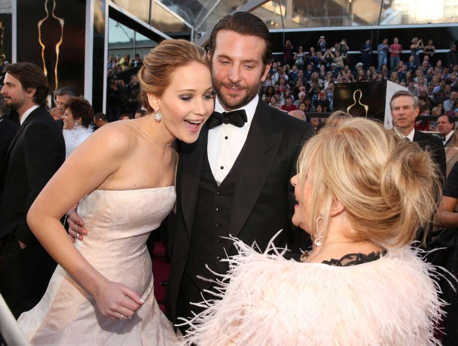 Actors Jennifer Lawrence, Bradley Cooper, and Jacki Weaver arrive at the Oscars held at Hollywood & Highland Center on February 24, 2013 in Hollywood, California.