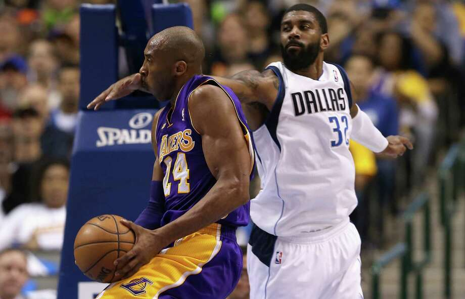 Kobe Bryant, left, burned O.J. Mayo and the Mavs for 38 points after Dallas owner Mark Cuban suggested Bryant could be an amnesty-clause candidate. Photo: Ronald Martinez, Staff / 2013 Getty Images