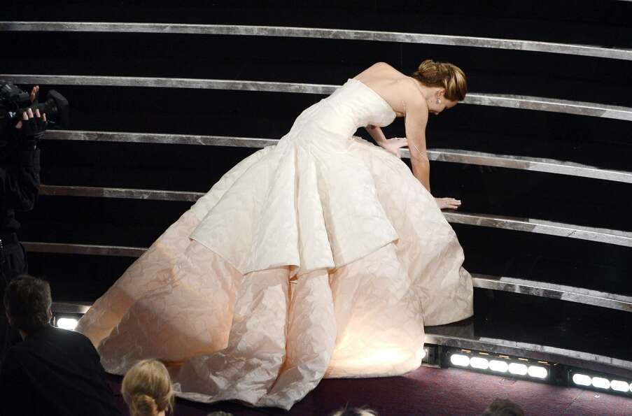 Actress Jennifer Lawrence reacts after winning the Best Actress award for Silver Linings Playbook du