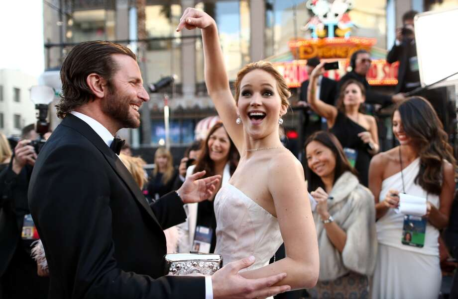 Actors Bradley Cooper and Jennifer Lawrence arrive at the Oscars held at Hollywood & Highland Center on February 24, 2013 in Hollywood, California.