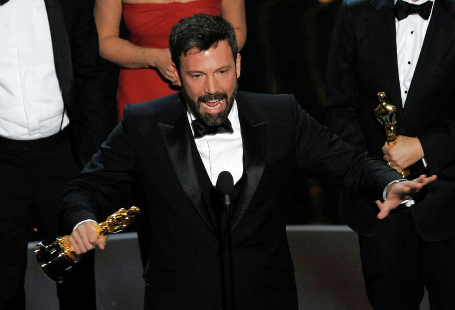 "Director/producer Ben Affleck accepts the award for best picture for ""Argo"" during the Oscars at the Dolby Theatre on Sunday Feb. 24, 2013, in Los Angeles. Photo: Chris Pizzello, Associated Press / Invision"