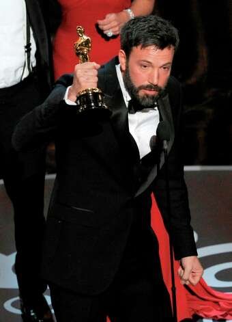 Ben Affleck accepts the award for best picture for Argo during the Oscars at the Dolby Theatre on Sunday Feb. 24, 2013, in Los Angeles.  (Photo by Chris Pizzello/Invision/AP) Photo: Chris Pizzello, Associated Press / Invision