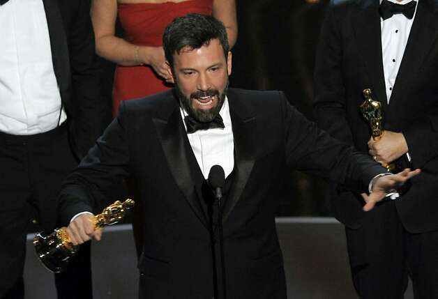 "Director/producer Ben Affleck accepts the award for best picture for ""Argo"" during the Oscars at the Dolby Theatre on Sunday Feb. 24, 2013, in Los Angeles. (Photo by Chris Pizzello/Invision/AP) Photo: Chris Pizzello, Associated Press"
