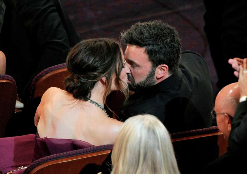 Jennifer Garner, left, kisses husband and director Ben Affleck after Argo is announced the winner fo