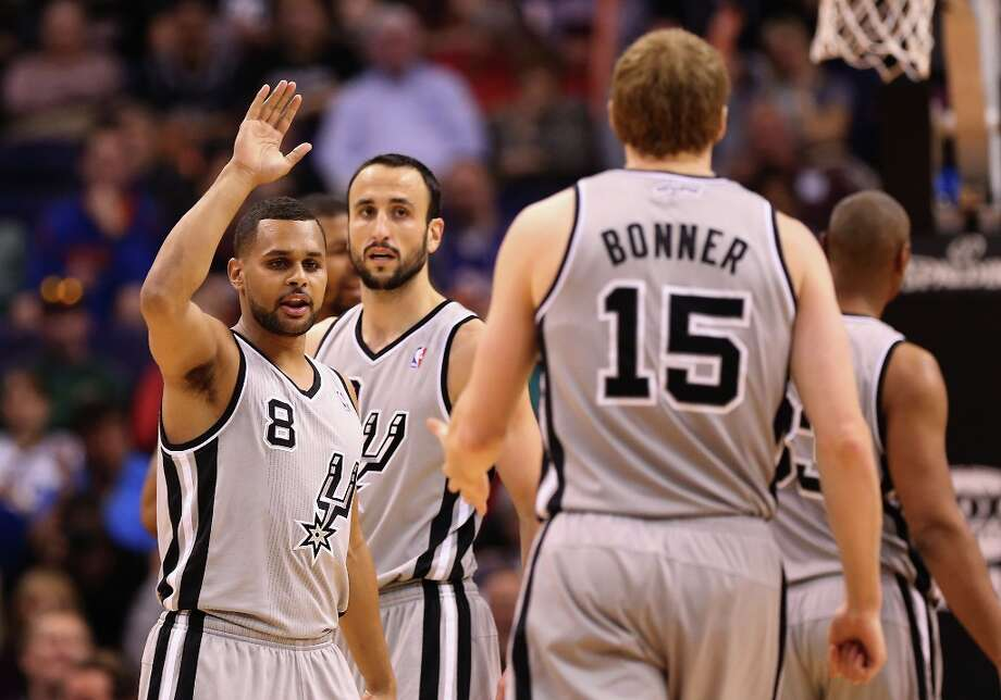 Patty Mills #8 of the Spurs high fives Matt Bonner #15 after scoring against the Suns during the second half at US Airways Center on Feb. 24, 2013 in Phoenix. Photo: Christian Petersen, Getty Images / 2013 Getty Images