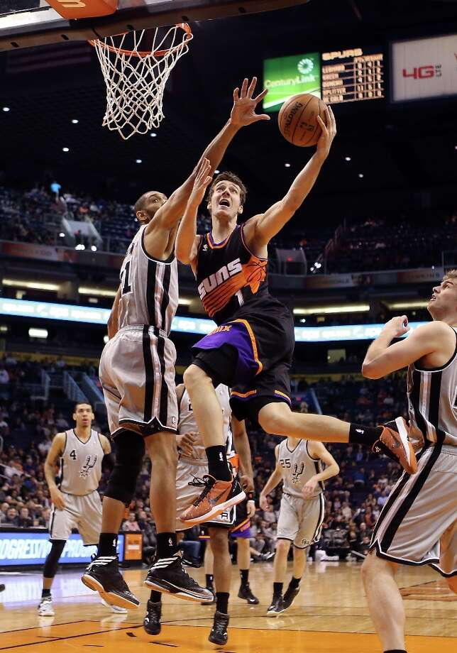 Goran Dragic #1 of the Suns lays up a shot past Tim Duncan #21 of the Spurs during the second half at US Airways Center on Feb. 24, 2013 in Phoenix. Photo: Christian Petersen, Getty Images / 2013 Getty Images