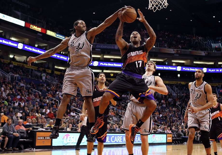 The Spurs' Kawhi Leonard (left) blocks a shot by P.J. Tucker #17 of the Suns during the second half at US Airways Center on Feb. 24, 2013 in Phoenix. Photo: Christian Petersen, Getty Images / 2013 Getty Images