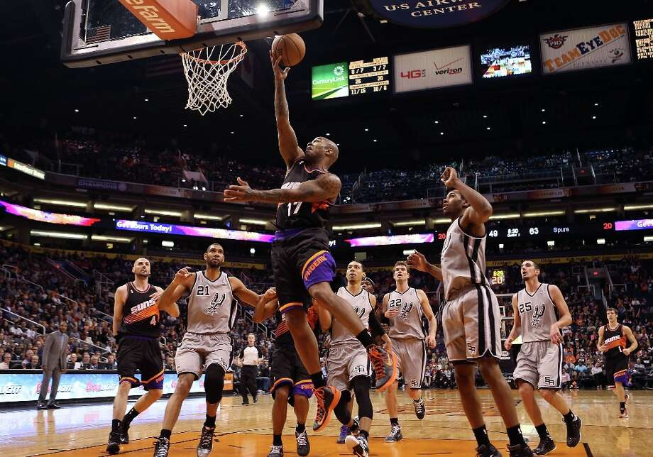 P.J. Tucker #17 of the Suns puts up a shot against the Spurs during the second half at US Airways Center on Feb. 24, 2013 in Phoenix. Photo: Christian Petersen, Getty Images / 2013 Getty Images