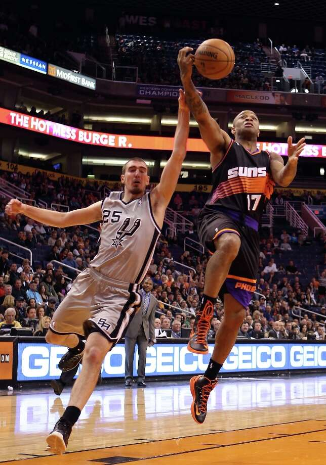 P.J. Tucker #17 of the Suns attempts a shot pressured by Nando de Colo #25 of the Spurs during the second half at US Airways Center on Feb. 24, 2013 in Phoenix. Photo: Christian Petersen, Getty Images / 2013 Getty Images