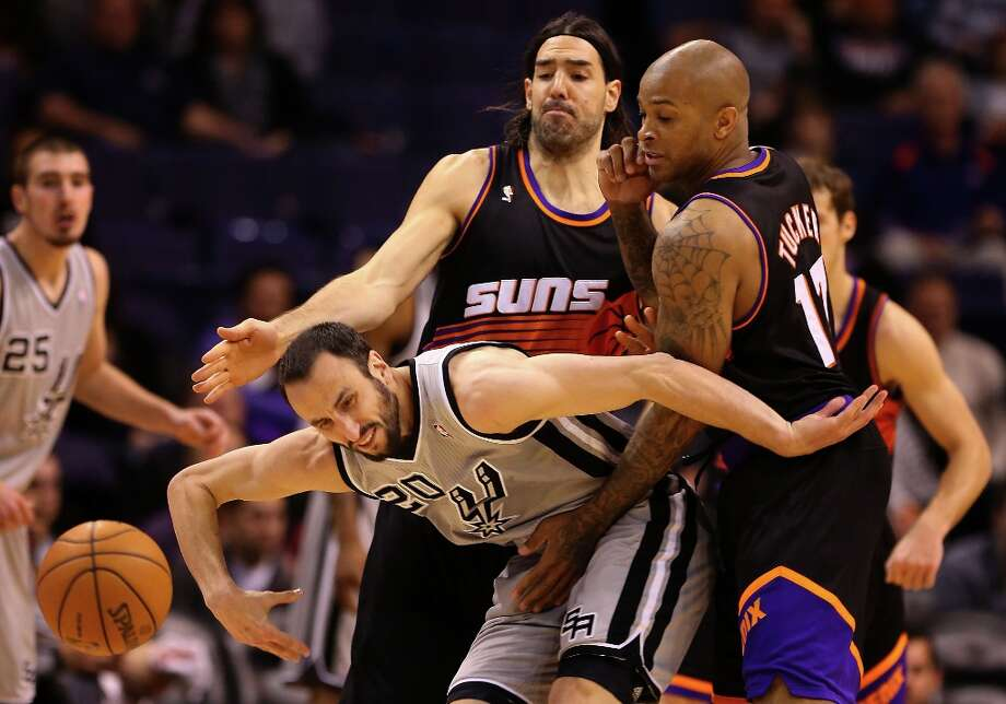 Manu Ginobili #20 of the Spurs loses the ball guarded by Luis Scola #14 and P.J. Tucker #17 of the Suns during the second half at US Airways Center on Feb. 24, 2013 in Phoenix. Photo: Christian Petersen, Getty Images / 2013 Getty Images