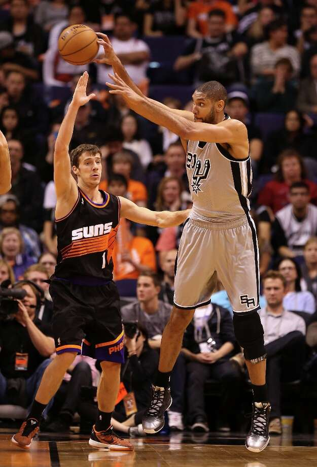 Tim Duncan #21 of the Spurs passes the ball around Goran Dragic #1 of the Suns during the second half at US Airways Center on Feb. 24, 2013 in Phoenix. Photo: Christian Petersen, Getty Images / 2013 Getty Images