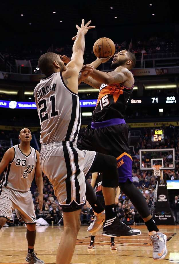 Marcus Morris #15 of the Suns attempts a shot over Tim Duncan #21 of the Spurs during the second half at US Airways Center on Feb. 24, 2013 in Phoenix. Photo: Christian Petersen, Getty Images / 2013 Getty Images