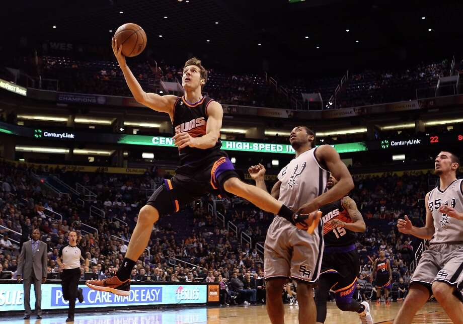 Goran Dragic #1 of the Suns lays up a shot past Kawhi Leonard #2 of the Spurs during the second half at US Airways Center on Feb. 24, 2013 in Phoenix. Photo: Christian Petersen, Getty Images / 2013 Getty Images