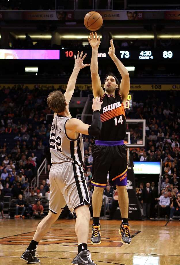 Luis Scola #14 of the Suns puts up a shot over Tiago Splitter #22 of the Spurs at US Airways Center on Feb. 24, 2013 in Phoenix. Photo: Christian Petersen, Getty Images / 2013 Getty Images