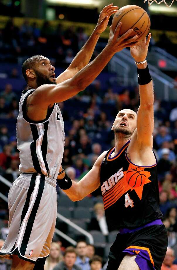 The Spurs' Tim Duncan has his shot blocked by the Suns' Marcin Gortat during the first half Sunday, Feb. 24, 2013, in Phoenix. Photo: Matt York, Associated Press / AP